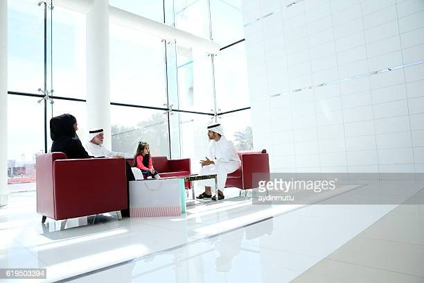 Middle Eastern family in shopping mall
