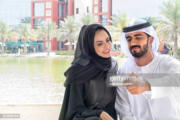 Middle Eastern family looking at mobile phone