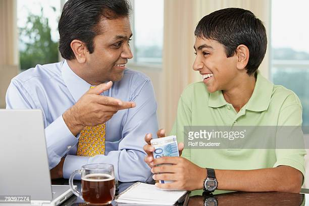 Middle Eastern father and son smiling at each other