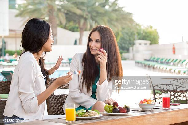 Middle Eastern Girlfriends Eating Healthy Lunch at Hotel Spa Resort