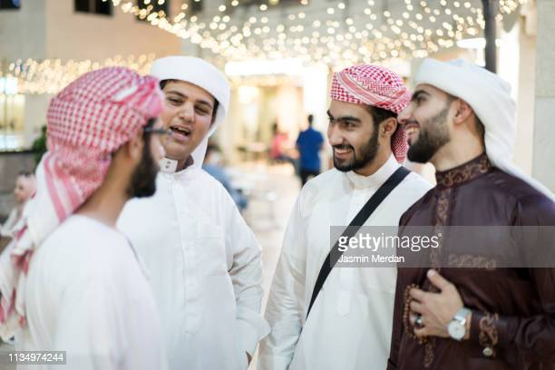 middle eastern group of young men together - headdress stock pictures, royalty-free photos & images