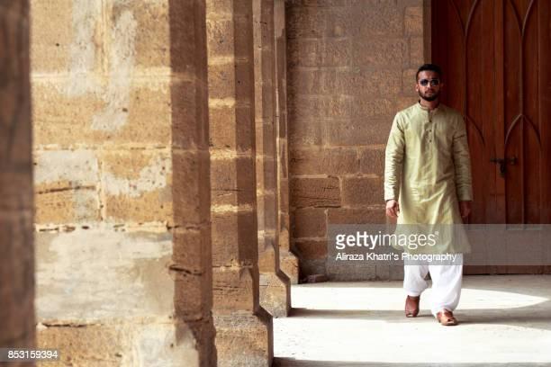 middle eastern india pakistan men's wear style - パキスタン ストックフォトと画像