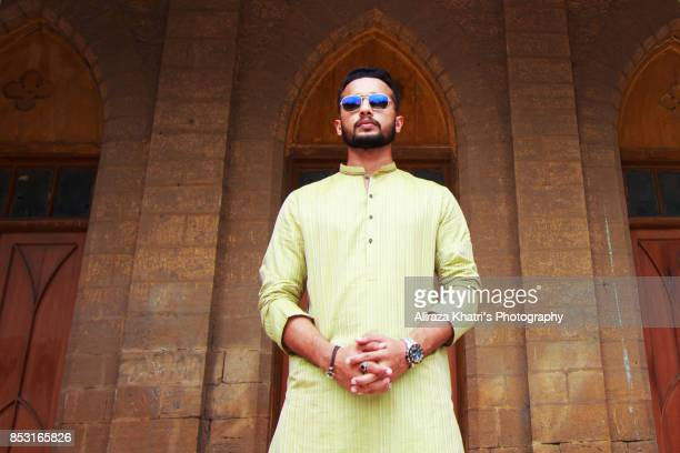 middle eastern india pakistan men's wear style - kurta stock pictures, royalty-free photos & images