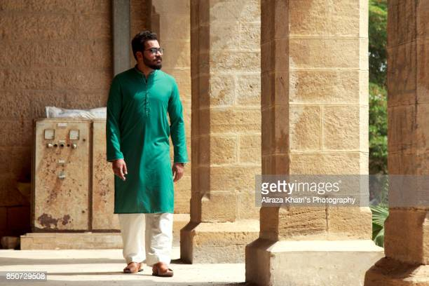 middle eastern india pakistan menswear style - kurta stock pictures, royalty-free photos & images