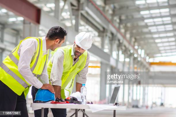 middle eastern male construction professionals onsite - man made space stock pictures, royalty-free photos & images