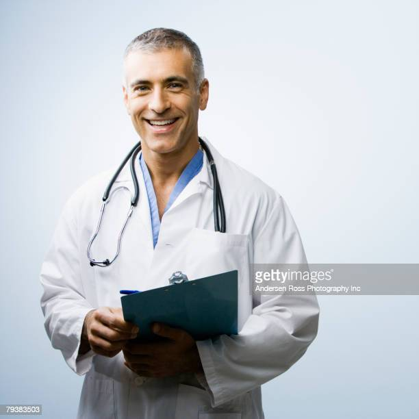 Middle Eastern male doctor holding chart