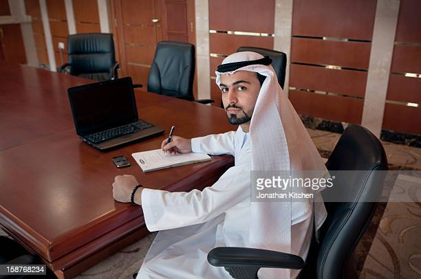 Middle eastern man at a desk doing business 2