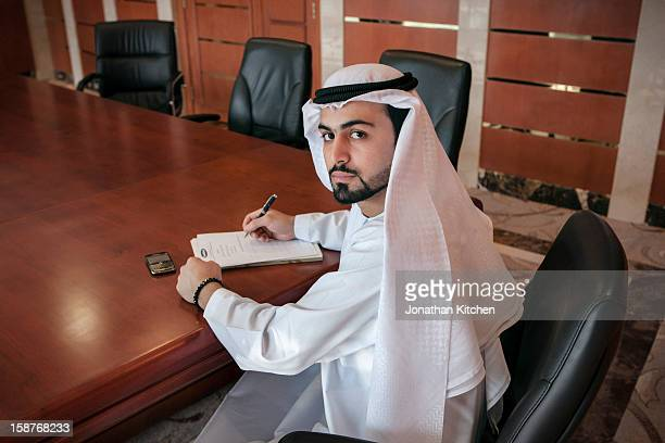 Middle eastern man at a desk doing business