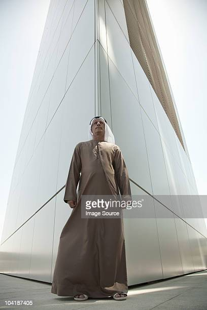 Middle eastern man by modern dubai building
