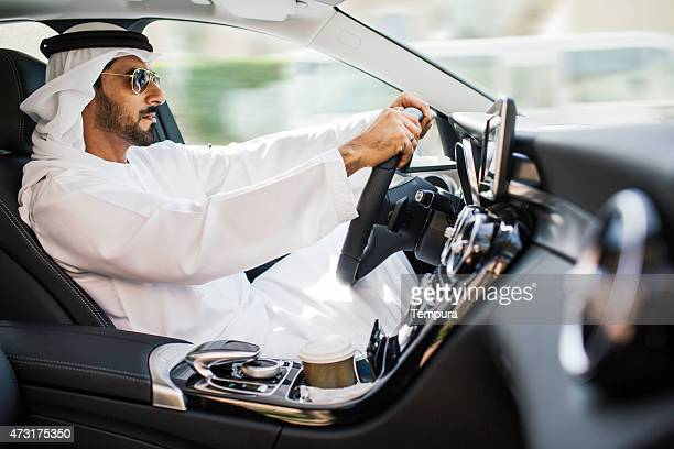 Middle eastern man driving a luxury car in Dubai