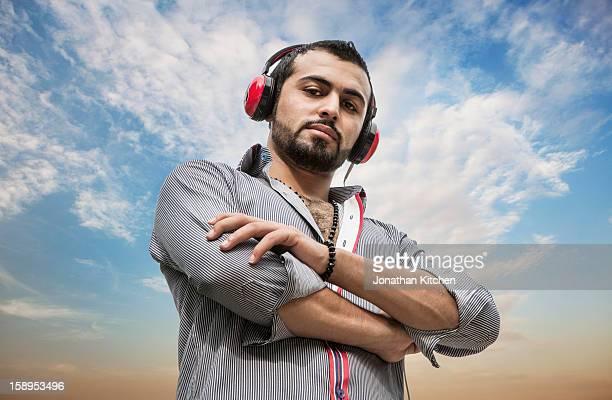 Middle eastern man enjoying listening to music 2