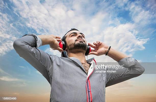 Middle eastern man enjoying listening to music