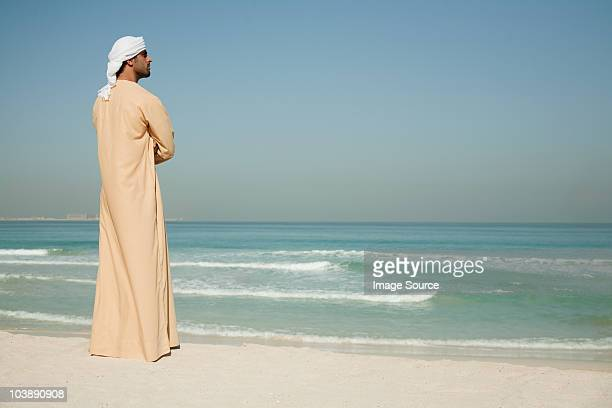 Middle Eastern man looking at sea, portrait