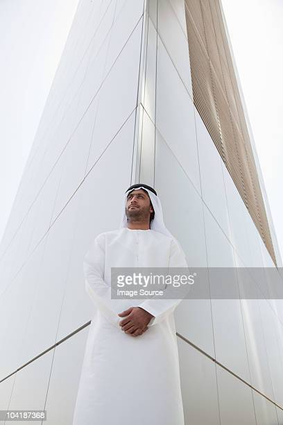 middle eastern man outside dubai building - kaffiyeh stock pictures, royalty-free photos & images