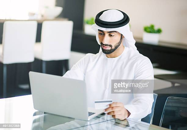 Middle Eastern Man Shopping Online