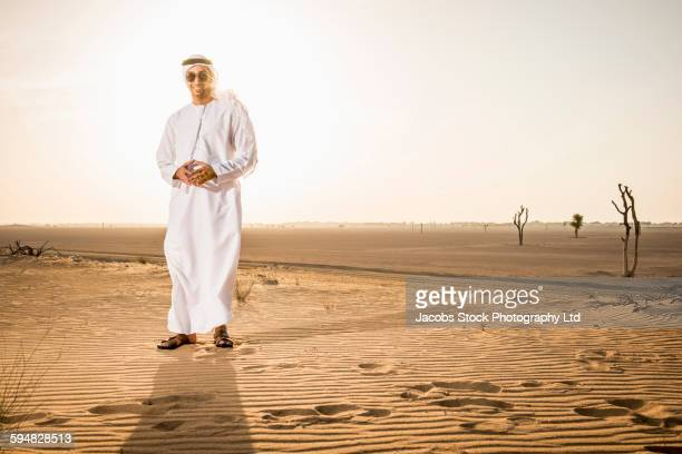 Middle Eastern man standing in desert