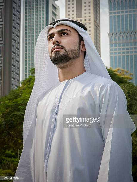 middle eastern man stands in front of buildings - looking up stock pictures, royalty-free photos & images