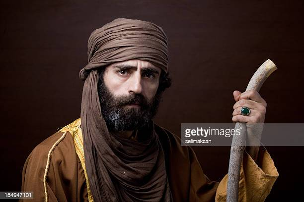 Middle eastern man with headscarf in traditional headscarf and clothing
