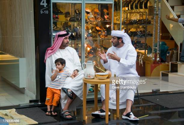 CONTENT] Middle Eastern men conversing in the Little Arabia district of Bangkok Thailand