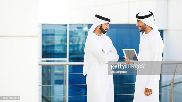 Middle Eastern Men Joking With Each Other Outside The Office