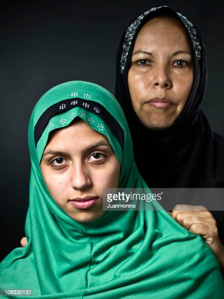 middle eastern mother and her daughter - pakistan girl stock photos and pictures