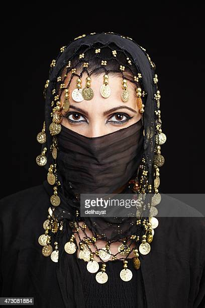 middle eastern muslim woman - muslim woman darkness stock photos and pictures