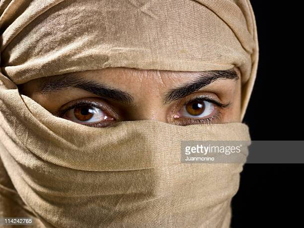 middle eastern muslim woman wearing a veil - sharia stock photos and pictures