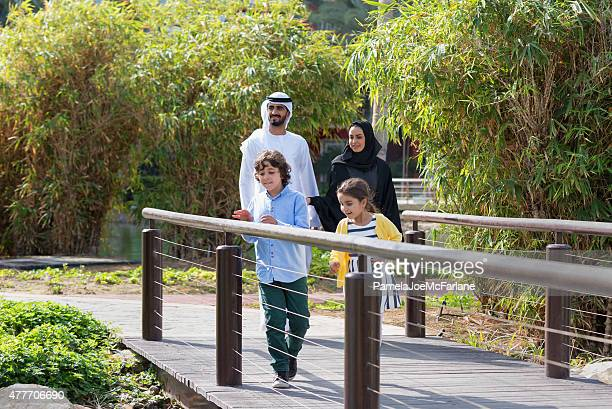 Middle Eastern Parents and Children Enjoying Park Garden