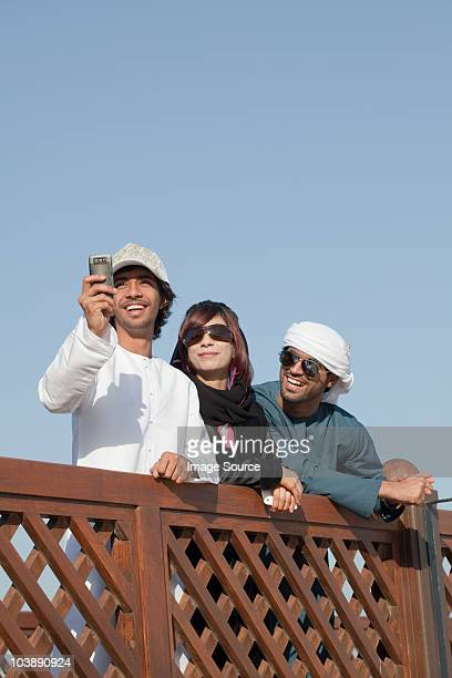 Middle Eastern people by fence, low angle view
