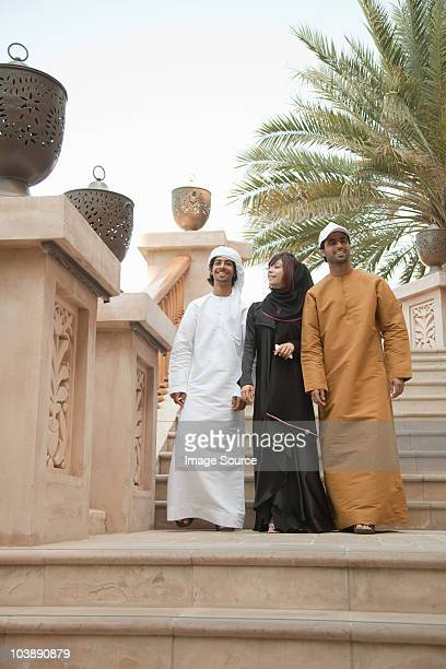 Middle Eastern people walking down steps