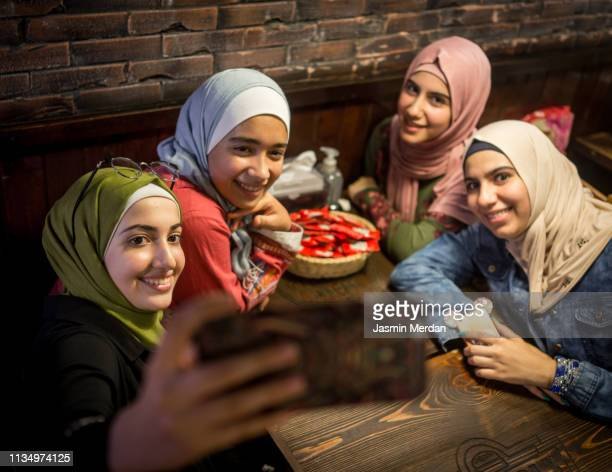 middle eastern teenage girls taking selfie - ramadan stock pictures, royalty-free photos & images