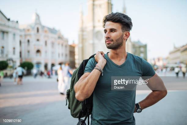 middle eastern tourist in the city in summer - half shaved hairstyle stock pictures, royalty-free photos & images