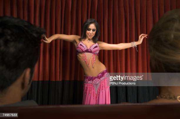 Middle Eastern woman belly dancing on stage
