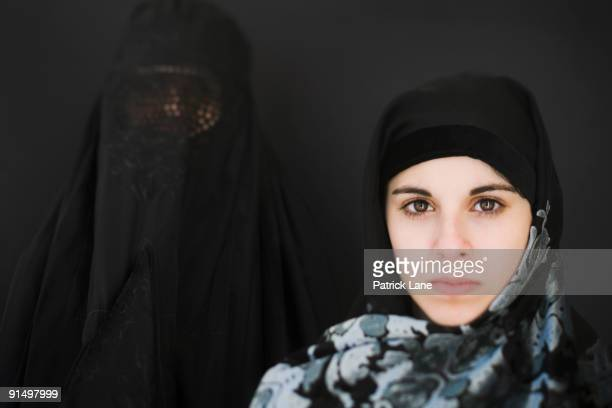 Middle Eastern woman in burka and teenager in headscarf