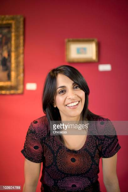 middle eastern woman in museum - museum curator stock pictures, royalty-free photos & images
