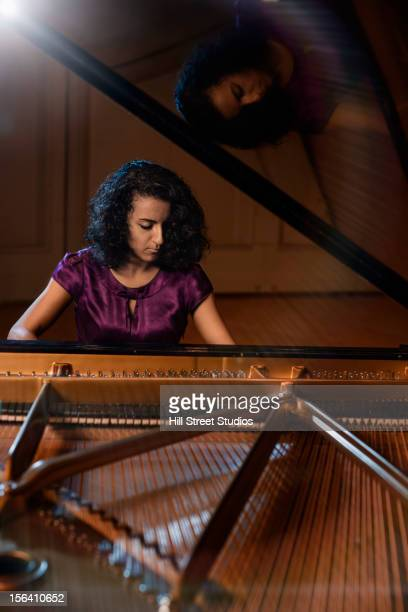 middle eastern woman playing piano - pianist front stock pictures, royalty-free photos & images