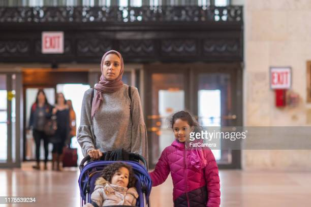 middle eastern woman shopping with her daughters - family politics stock pictures, royalty-free photos & images