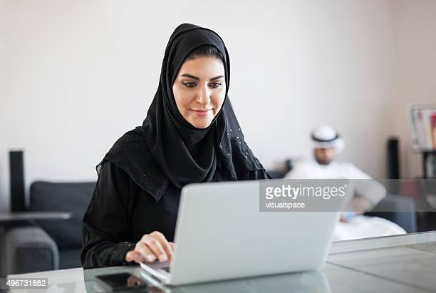 Middle Eastern Woman Using Computer at Home