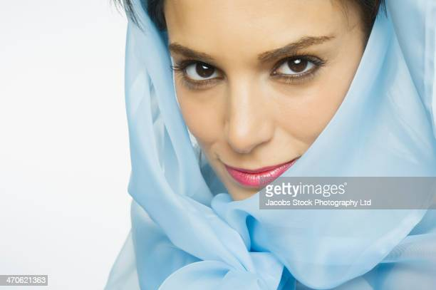 Middle Eastern woman wearing blue veil