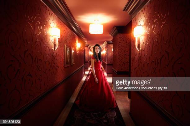middle eastern woman wearing evening gown in hallway - evening gown stock pictures, royalty-free photos & images