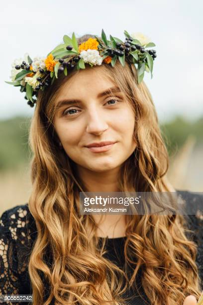 Middle Eastern woman wearing flower crown outdoors