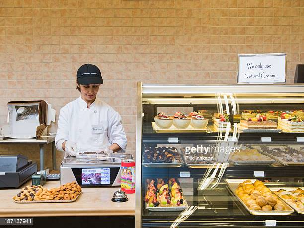 Middle Eastern woman working in bakery