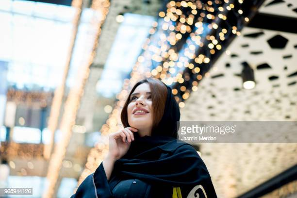 Middle Eastern young woman in shopping