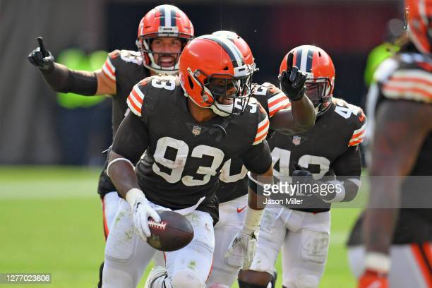 Middle linebacker B.J. Goodson of the Cleveland Browns celebrates after grabbing an interception during the fourth quarter against the Washington...