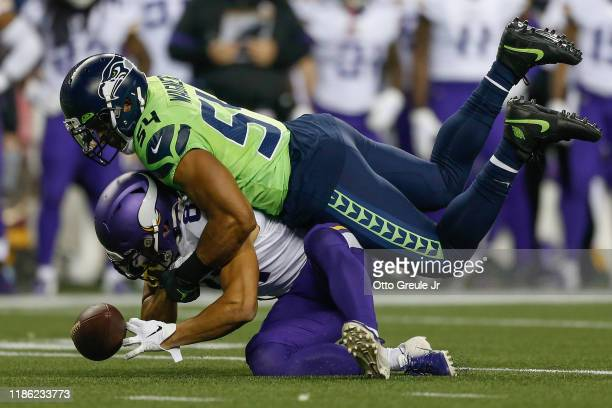 Middle linebacker Bobby Wagner of the Seattle Seahawks breaks up a pass intended for wide receiver Bisi Johnson of the Minnesota Vikings at...