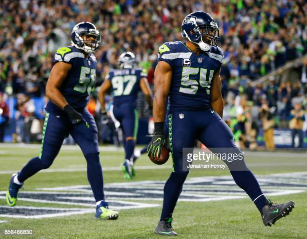 Middle linebacker Bobby Wagner of the Seattle Seahawks celebrates his fumble recovery for a touchdown against the Indianapolis Colts in the third...