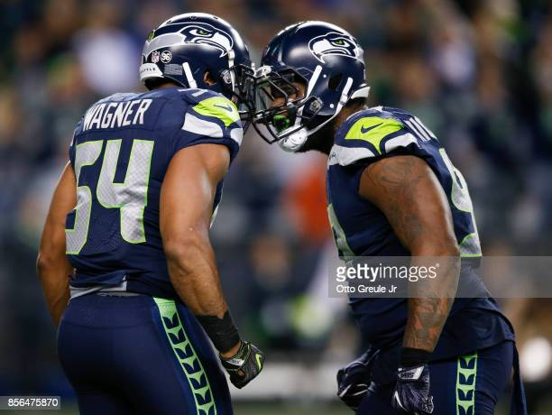 Middle linebacker Bobby Wagner of the Seattle Seahawks celebrates his fumble recovery for a touchdown with defensive tackle Sheldon Richardson the...