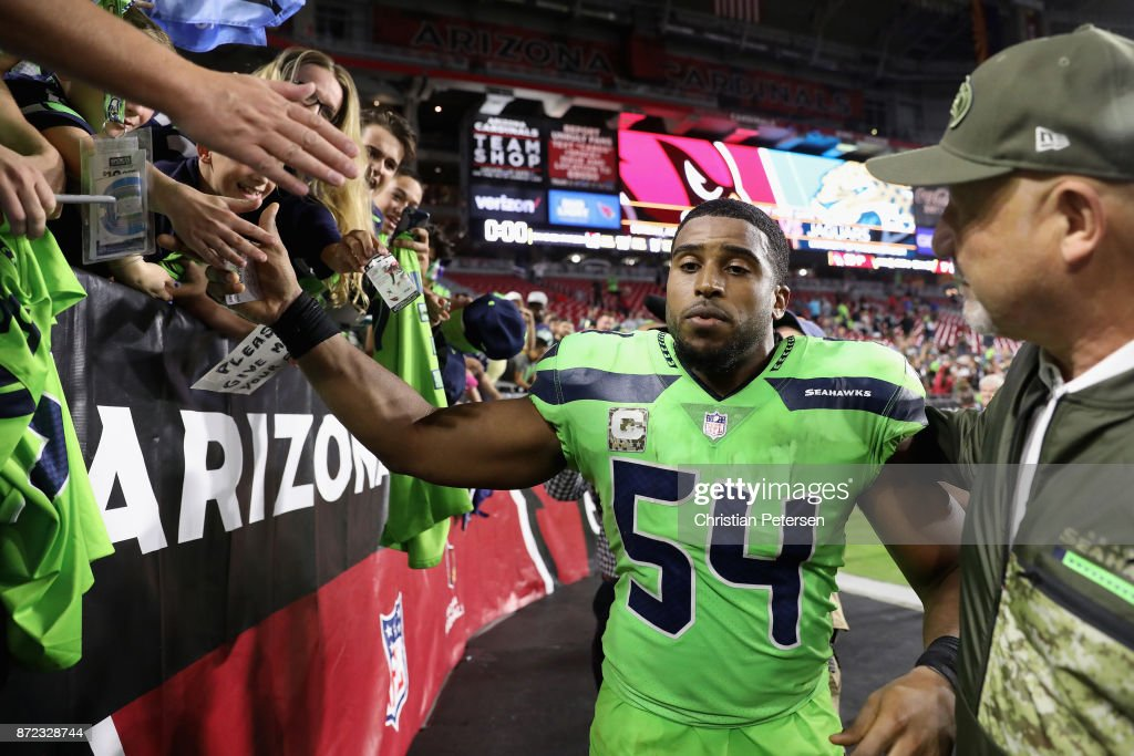 Middle linebacker Bobby Wagner #54 of the Seattle Seahawks high fives fans following the NFL game against the Arizona Cardinals at the University of Phoenix Stadium on November 9, 2017 in Glendale, Arizona. The Seahawks defeated the Cardinals 22-16.