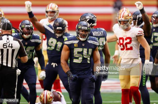 Middle linebacker Bobby Wagner of the Seattle Seahawks reacts to a sack on quarterback C.J. Beathard of the San Francisco 49ers during the first half...