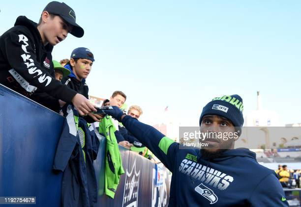 Middle linebacker Bobby Wagner of the Seattle Seahawks signs autographs before the game against the Los Angeles Rams at Los Angeles Memorial Coliseum...